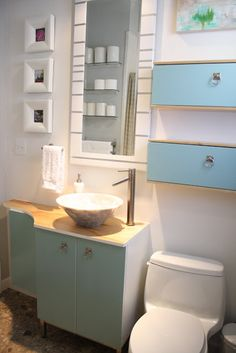 The cabinets over the toilet! (Ikea Bjorken, hugh sideways, enamel painted, new hardware