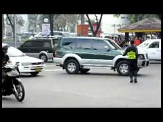 Filipino Traffic Cop Doing His Job Like A Boss but no one ever seems to stop