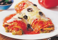117 Chicken Enchilada Oven roasted chicken and bell peppers rolled in two tortillas and topped with creamy tomato sauce, black olives and cheese