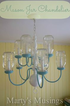 This unique DIY Mason Jar Chandelier is made from an old 10 light brass chandelier with shades. Mason jars are turned upside down and chandelier is painted. Great tutorial with tips and tricks from Marty's Musings