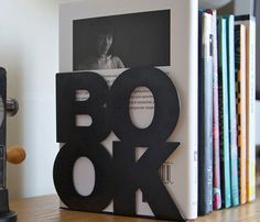 BookOne Bookends - sells for $29.69 on uncovet, but i'm sure these could be easily made out of some styrofoam and paint.
