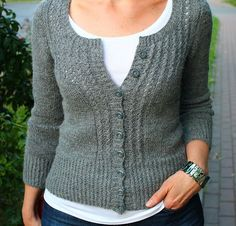 Small ultra-feminine cardigan with puffed sleves. Knitted without seaming.