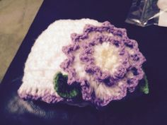 Baby crochet hat with purple trim and green leaf.  #Izzy Belle creations
