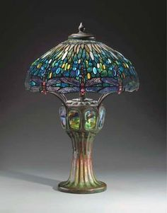 A fabulous Tiffany Studios (1895-1933) dragonfly design blue shaded lamp with very rare glass base. (I have an exact replica in my living room.)