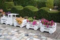 Wooden Train Garden Planter Made With Crates Video Tutorial Garden Crafts, Garden Projects, Wooden Train, Outdoor Furniture Sets, Outdoor Decor, Garden Planters, Log Planter, Planter Ideas, Outdoor Projects
