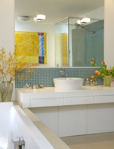 Beautiful tulips and yellow tree branches in the #bathroom