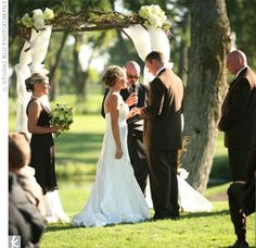 Outdoor ceremony wedding arbor.