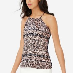 The Limited Printed Halter Top Small NWT $39.95 Printed crepe de chine front, lightweight knit back. Button front keyhole. Front: 100% polyester; Back: 95% rayon, 5% spandex. Mach wash. Small. NWT $39.95. The Limited Tops