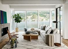 For one project, a 1970s cottage she recently finished with architect Cass Calder Smith, designer Nicole Hollis took her cues from the home's natural surroundings—set above a lagoon, the house has floor-to-ceiling windows that look out onto the Marin Headlands. #marincounty #californiahome #home #lakehouse #hometour #beachhouse #luxury #interiordesign #architecture #decor #outdoorspace #backyard #modernhome #cottage #elledecor Outdoor Furniture Sets, House Design, Decor, Interior Design, House Interior, Elle Decor, Home, White Interior, Beach Living Room