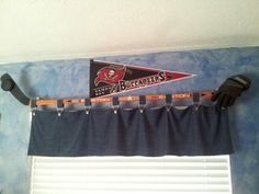 Sports bedroom: Use an old hockey stick, glue a puck, and position a hockey glove...easy curtain rod! My son has two windows on adjacent walls so we arranged the sticks so it looks like two players going for the puck.