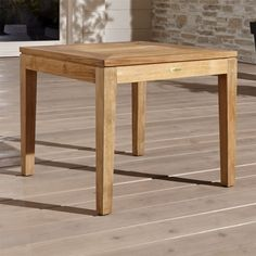 Shop Regatta Natural Stacking Side Table. Square side table with bold, wide-slatted top and tapered legs stacks two high for convenient storage. The Regatta Natural Outdoor Stacking Side Table is a Crate and Barrel exclusive.