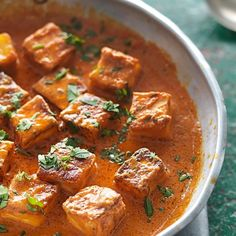 Fresh Indian Cheese in a Butter Tomato Sauce (Paneer Makhani) from Madhur Jaffrey's Curry Easy Vegetarian cookbook. This delicious recipe is perfect to serve as a vegetarian main or as a side dish and is generally eaten with Indian flatbreads, especially naans.