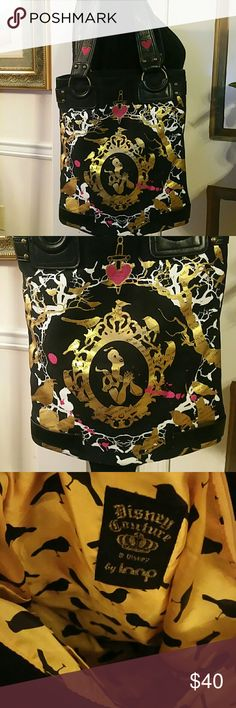 Disney Couture Snow White Bag For consideration is this black, gold, white and fuschia tote bag. The accents is faux leather. It has a snapped closure at the top with zippered inside pocket. This us a pre-owned bag with normal wear around the handles. Good condition for its age. Disney Bags Totes