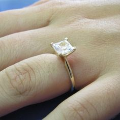 1 1/4 ct princess cut solitare. If only it were white gold, it's perfect