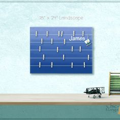 A beautiful way to display your cards and memos and decorate any room.  This display board can be hanged in a kids room, teens room, office, kitchen, family space and more. Personalization option. 10 design options.  Hand painted canvas with wooden clothespins.  #giftforher #Bulletinboard #cardsdisplay #navyblueombre #ombre #blue #navyroomdecor #girlsroom #giftforgirl #teensroom #officeorganizer #memoholder #homeorganizer #personalizedgift #giftforteens #freeshipping #christmasgift…