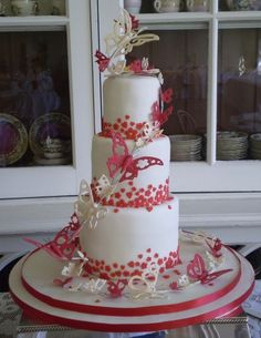 Google Image Result for http://www.icemaidencakes.com/wp-content/uploads/Butterfly-Spiral-Wedding-Cake-425x550.jpg