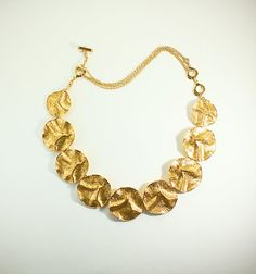 90c86994e4 Items similar to Vintage YSL Yves Saint Laurent Necklace Textured Round  Gold Tone Metal 1980s on Etsy