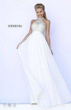 Sherri Hill 5204 has a great beaded bodice on high-neck neckline. The beaded pattern is so intricate made of a crystal bead that will look great under the dance lights. Sherri Hill 5204 is an empire waist gown with a flowing skirt that will look great on you!