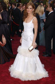 Sandra Bullock at the 2004 Academy Awards: Sandra Bullock wore a girly Oscar de la Renta gown in 2004.