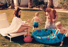 Brad and Angelina: Domestic Bliss - Angelina Jolie in Yves Saint Laurent and Brad Pitt, playing with children