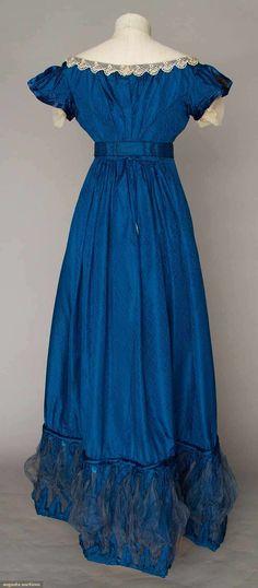 COBALT SILK EVENING GOWN, 1820s Figured cobalt blue silk, empire bodice w/ laced V front satin panel, short cap sleeves, Lille lace trim, inset waist band, mesh puff hem trims