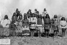 Geronimo Surrenders: Geronimo (1829-1909), the Apache Chief who led resistance to U.S. policy stands with other Apache warriors, women and children shortly before his surrender on March 27, 1886. (Photo Credit: Bettmann/CORBIS)
