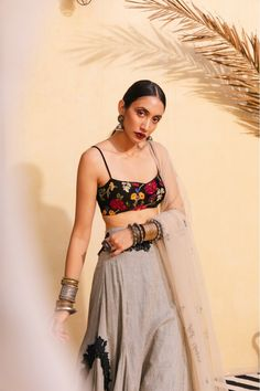 A whimsical lehenga set with a velvet bralette crop, embroidered with intricate silk thread detail and gold thread to appear like tapestry, an ecru and black check skirt with applique and beaded tassels and a tulle dupatta hand embroidered with stars and Ethnic Outfits, Indian Outfits, Fashion Outfits, Women's Fashion, Lehenga Designs, Saree Blouse Designs, Indian Attire, Indian Ethnic Wear, Dress Indian Style