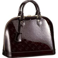 Louis Vuitton.  Usually I'm not one for designer logos and tags, but I can make an exception for this one.