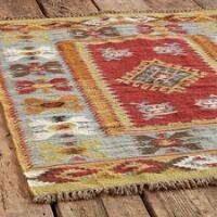 Adapting patterns from old Turkish kilims, village weavers recreate handwoven rugs on primitive looms, handwashing them to soften color and texture. Handmade Shop, Handmade Rugs, Lodge Decor, Large Rugs, Blue Earrings, Wool Yarn, Floor Rugs, Kilim Rugs, Bohemian Rug