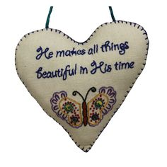 Add a touch of whimsy and encouragement to your doors and walls with this handmade heart linen sign. With high quality, soft cotton embroidered with letters and butterfly, this sign reads: 'He makes all things beautiful in His time.'