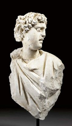 A PALMYRENE STUCCO DRAPED BUST OF A MAN CIRCA 2ND-3RD CENTURY A.D. | Christie's
