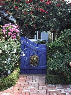 Even without the beautiful garden, this gate would stand on it's own good #garden design #garden interior| http://beautifulgardendecorstessie.blogspot.com