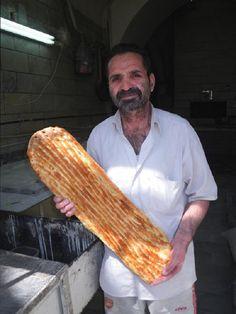 Shater showing barbari bread, Fars province, Iran, 2013, photo Kombizz Kashani