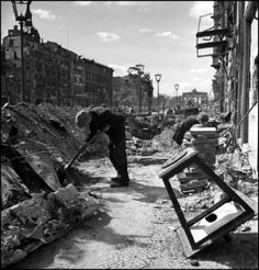 2000-lightyearsfromhome:  Robert Capa © International Center of Photography The ruins of an avenue leading towards the Western sector near the Brandenburg Gate.