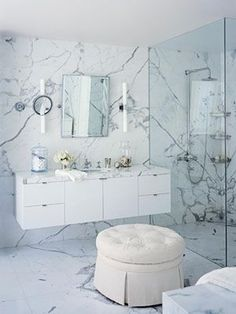 Monochromatic in the Master Bathroom: In master bathroom, Carrara bianco statuario marble walls, countertop and floor.