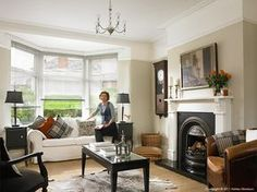 Janet Hamilton in the living room of her newly refurbished 1930's semi in Belfast by Ashley Morrison.