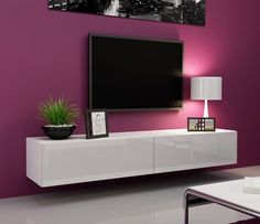 wonderful-furniture-wall-design-ideas-with-flat-tv-wall-mount-on-the-purple-wall-paint-color-also-white-shades-table-lamp-and-black-bowl-plant-pot-on-the-floating-white-cupboard-with-tv-wall-mounting.jpg (564×486)