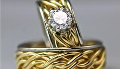 Six Strand Open Weave with a center braid in 14k yellow gold and 14k white gold with a .75ct SI1 round diamond in a prong setting.