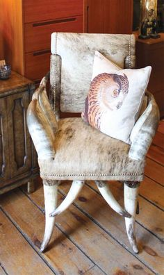 "SPRUCE DESIGN + DECOR RHINEBECK, 845-876-5864 ""Longhorn and Cowhide Bergere. Call it a chair. Call it a sculpture. Call it fabulous! Brindle cowhide and triple horn arms with silver nail-head details. It just possesses such amazing style and can go in so many different design settings: modern, cabin chic, or mountain lodge."""