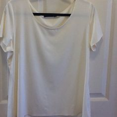 Off-White BlouseNever Worn Cute off-white blouse. Never worn- is in perfect  condition. Great basic blouse, will go with everything! Size XL. 90% Nylon & 10% Spandex. Feels very soft. Notations Tops Blouses