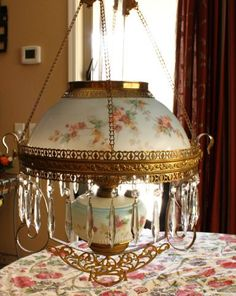 Antique Hanging Oil Lamp Light Parlor Lamp with matching painted light blue shade and font, gilded brass fixtures and hanging prisms