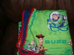 Toy Story baby blanket with crocheted edge.
