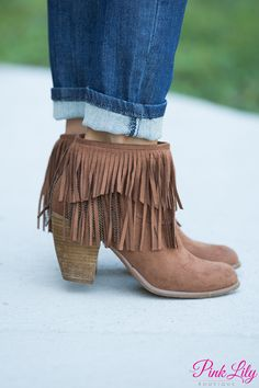 If you adore fringe, you have to have these beautiful new booties! Featuring a soft chestnut brown exterior with a gorgeous layer of fringe hanging down from the ankle, it's a stunning look that is so