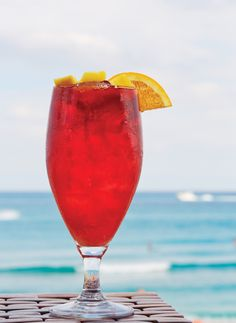 Sip on AB&G's Palm Beach Radius tea made with Mango & Orange Infused Vodka, Fresh Squeezed OJ, Hibiscus Tea and Mint | Four Seasons Resort Palm Beach