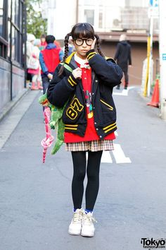 Yume is a 13-year-old Kyary Pamyu Pamyu fan who we see around Harajuku every so often. Her looks are always cute in a Kyary way! Here, she's wearing resale fashion, twintails, glasses & a 6%DOKIDOKI alligator backpack. Check all of Yume's snaps here: http://tokyofashion.com/kyary-pamyu-pamyu-cute-twintails/ #tokyofashion #fashion  #braids