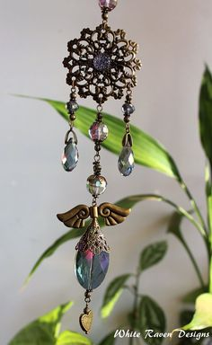 Sun catcher  light caster  Window ornament House jewellery Handcrafted by White Raven Designs for RavenshiresRealm