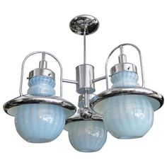 Mazzega Chandelier in Chrome and Opaline, Light Blue Glass | From a unique collection of antique and modern chandeliers and pendants  at https://www.1stdibs.com/furniture/lighting/chandeliers-pendant-lights/