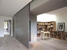 Modern Interior Design At Eco Sustainable House With White Oak Flooring And Grey Sliding Door As Room Divider Hide The Home Library Paris Home, Moving Walls, Movable Walls, Partition Wall Movable, Partition Walls, Panel Walls, Sliding Wall, Sliding Door Panels, Hanging Sliding Doors