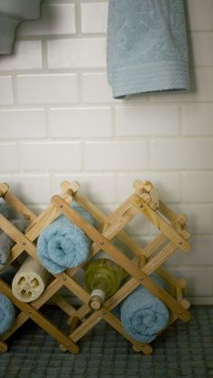Store bathroom towels in a wine rack on the floor.  Add interest by adding your favorite bottle of bubble bath and a loofah sponge.