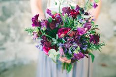 Purple sweet pea, clematic and maroon ranunculas bouquet. Rustic purple bouquet. Floral Design by Boutique Blooms: Photo Credit: Babb Photo